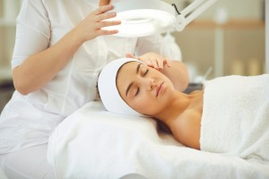 Facial,Treatment,And,Curing,Skin,Problems.,Cropped,Cosmetician,Using,Magnifying